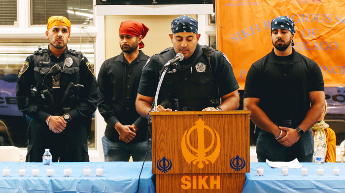 Officer Pardeep Singh Deol reading names of 94 police officers killed in line of duty this year_at candlelight vigil for Deputy Sandeep Singh Dhaliwal (1).JPG