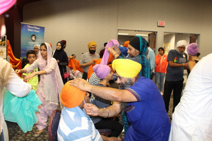 Turban Tying at the Festival.JPG
