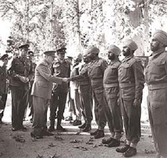 Prime Minister Winston Churchill meets with Sikh soldiers during WW-II Photo Courtesy IWM.London (67K)
