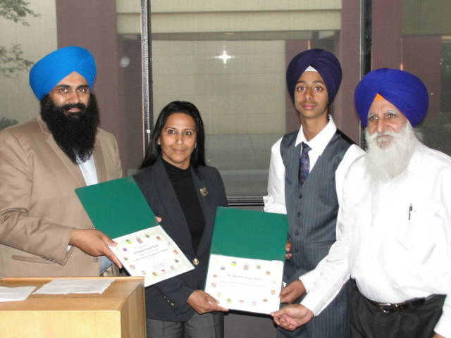 Tim Uppal and Grewal Honouring Bikram and Dr Bains with Appreciation Certificate (133K)