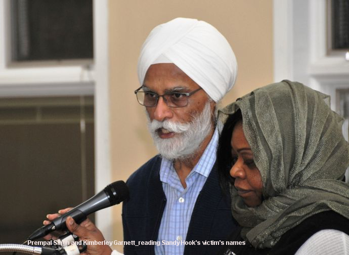 Prempal Singh and Kimberley Garnett_reading Sandy Hook's victim's names (146K)