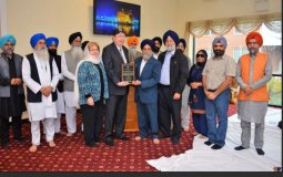 GGSF Chairman Inder Paul Singh Gadh honoring Rev Kaseman along with GGSF board members