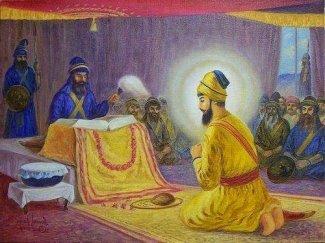 Guru_Gobind_Singh_bow_Guru_Granth.jpg