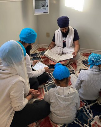 Kiran family reading.jpg