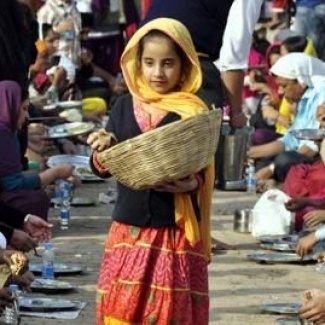 Sikh girl serving.jpg