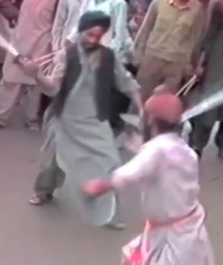afghan sikh men gatka.jpg