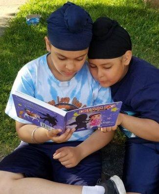 little kaur kids reading crop.jpg