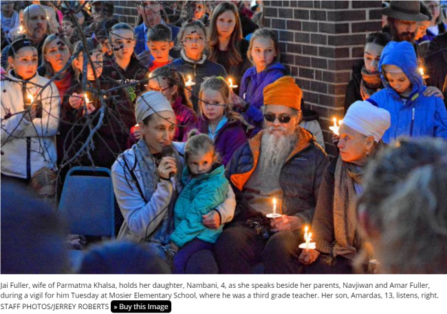 Khalsa remembrance vigil with candles.png