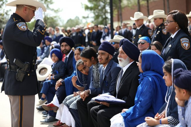 funeral of dhaliwal 16 family recieves salute.jpg