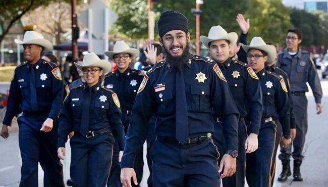 police amrit smile.jpg