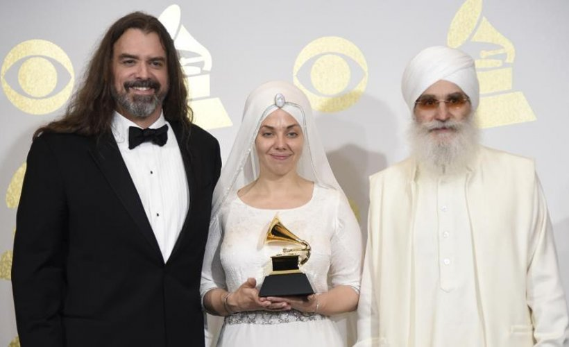 Adam Berry, Gurujas Khalsa and Hari Jiwan Singh Khalsa of the musical group White Sun after winning the award in Los Angeles. (AP File Photo)